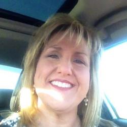 Cindi smiling in car
