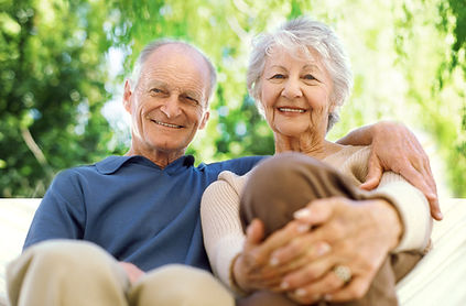 Stock image of an elderly white man and woman sitting together outside