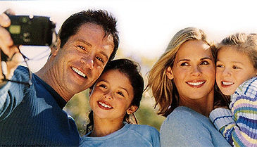 children with parents smiling