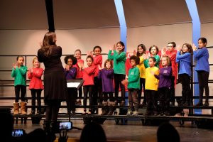 The Boston Children's Choir performs at the Fenn School during the MLK event.