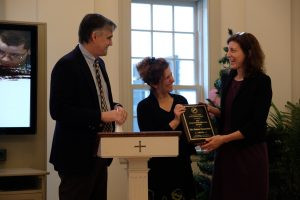 Sophie Wadsworth accepts the Climate For Freedom award from CCHRC co-chairs Rob Morrison and Ronni Olitsky
