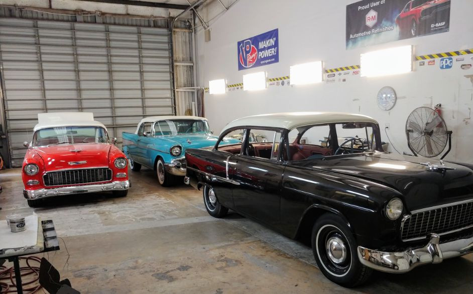 2 55_s and 57 chevy in body shop