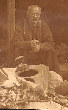 Guide Charles Beede with two men in leanto (1)_edited.jpg