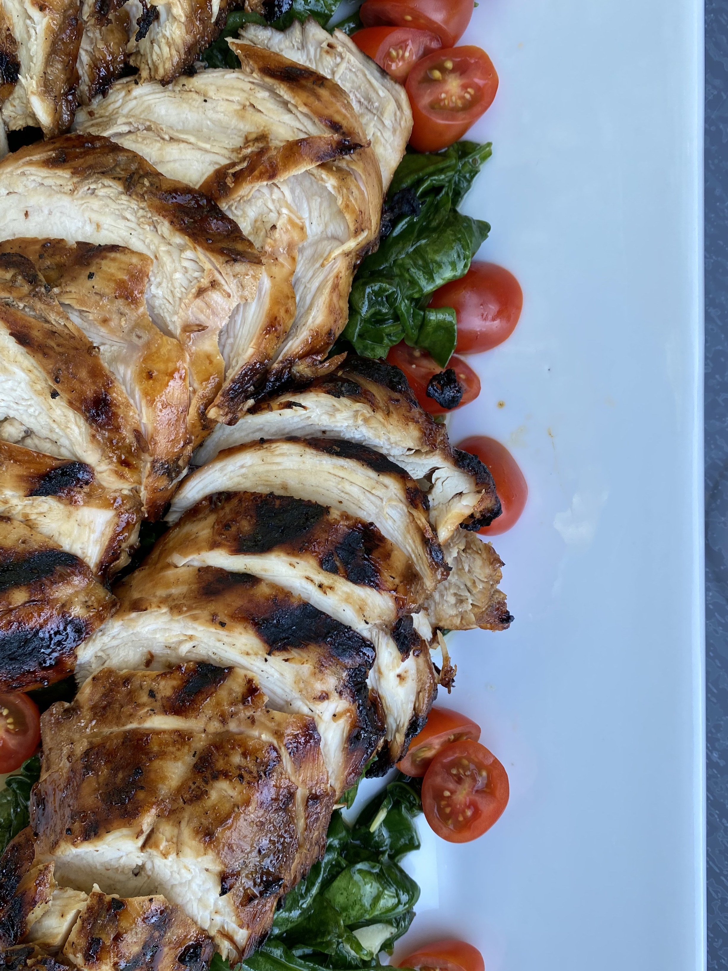 Grilled Chicken Over Garlicky Wilted Spinach