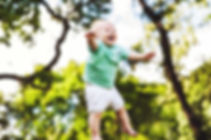 Baby boy jumping in the air