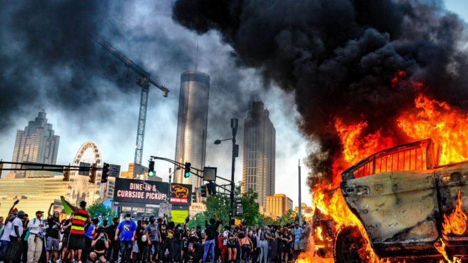 A strong picture of Protesting and riots in Atlanta