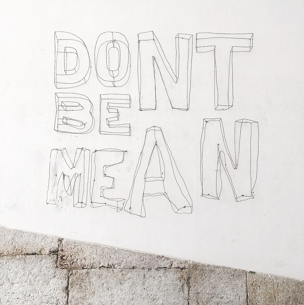"""Street art installation that reads, """"don't be mean."""""""