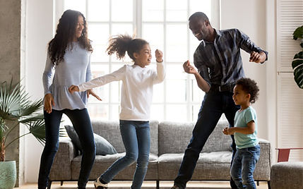 family-with-kids-dancing-in-livingroom.j