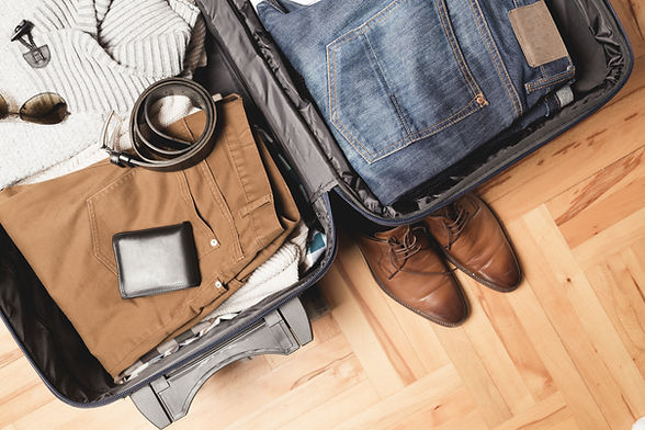 packed suitcase with travel tools