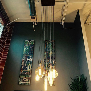 Recent custom lighting for a client. This seven pendant light fixture was the perfect fit for the client's industrial style loft.jpg