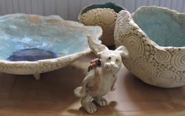 Hare wandering through stoneware bowls