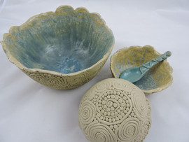 Three coiled galaxy glazed bowls and spoon