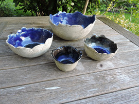 Coiled bowls with pools of glass
