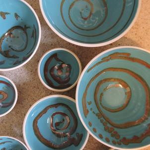 Turquoise bowls with metalic swirls