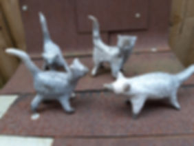 3 crackle glaze cats and  fox.  These ar