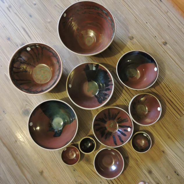 Meattlic brown glazed bowls with drips of chun blue glaze