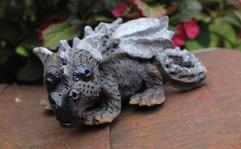 Raku dragon lying