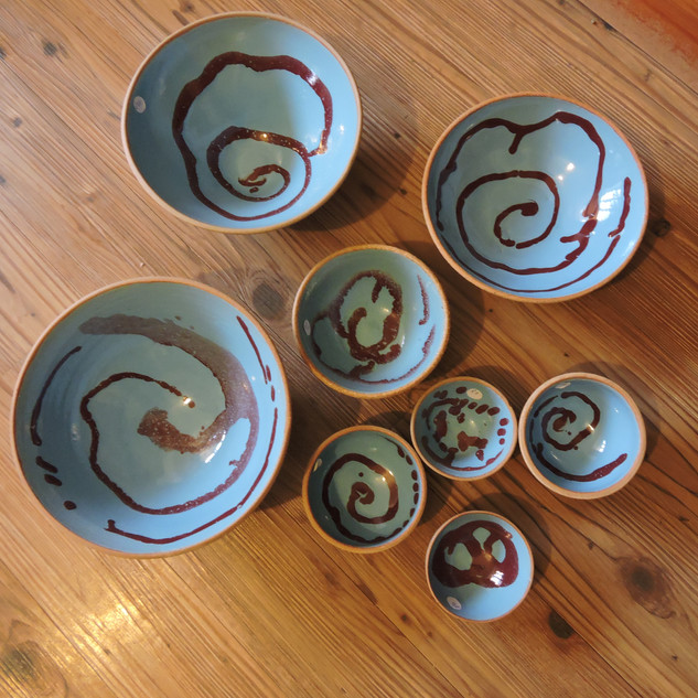 Robin's egg glazed bowls with maroonswirls