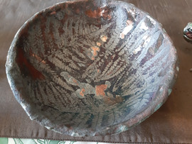 Leaf impressed raku bowl, highlighting copper reduction