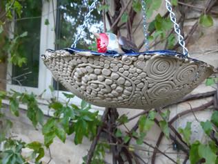Robin birdbath from underneath