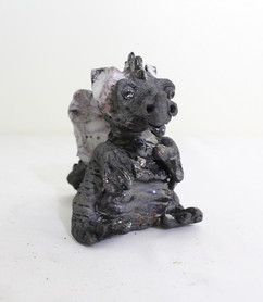Raku dragon sitting