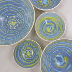Pastel bowls with yellow and light blue swirls