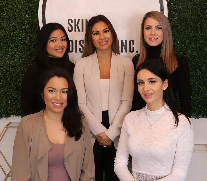 Staff image of beautiful girls at Skin District Inc.