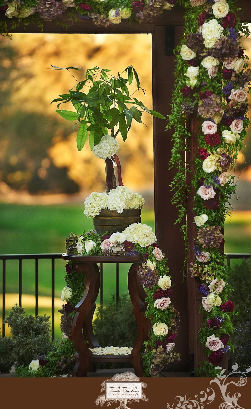 Arbor floral garland by Visual Impact Design | Ford Family Photography