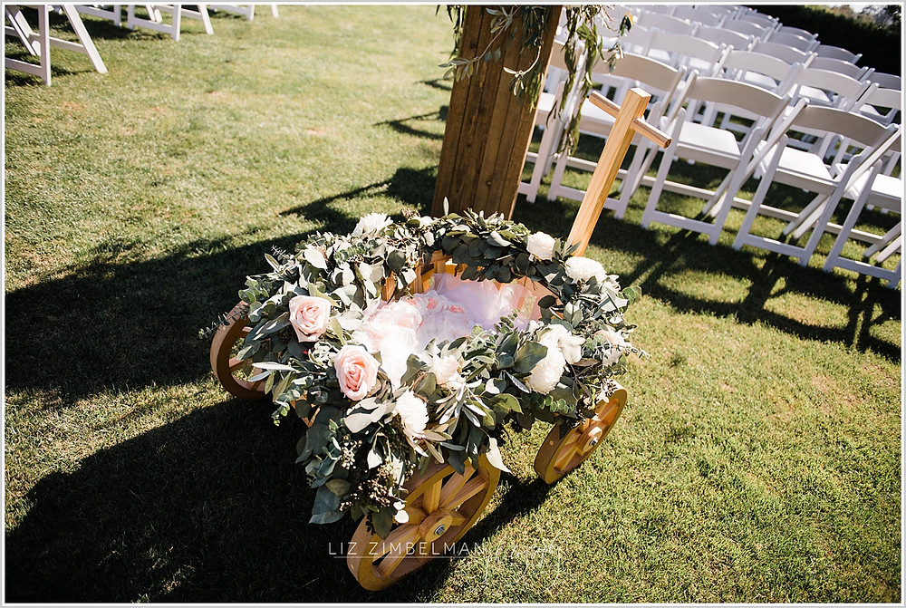 Wagon adorned with flowers for flower girl