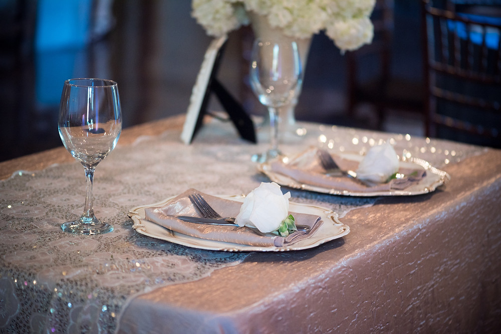 Rose buds at sweetheart table by Visual Impact Design | Photo by Allison Stahl Studio