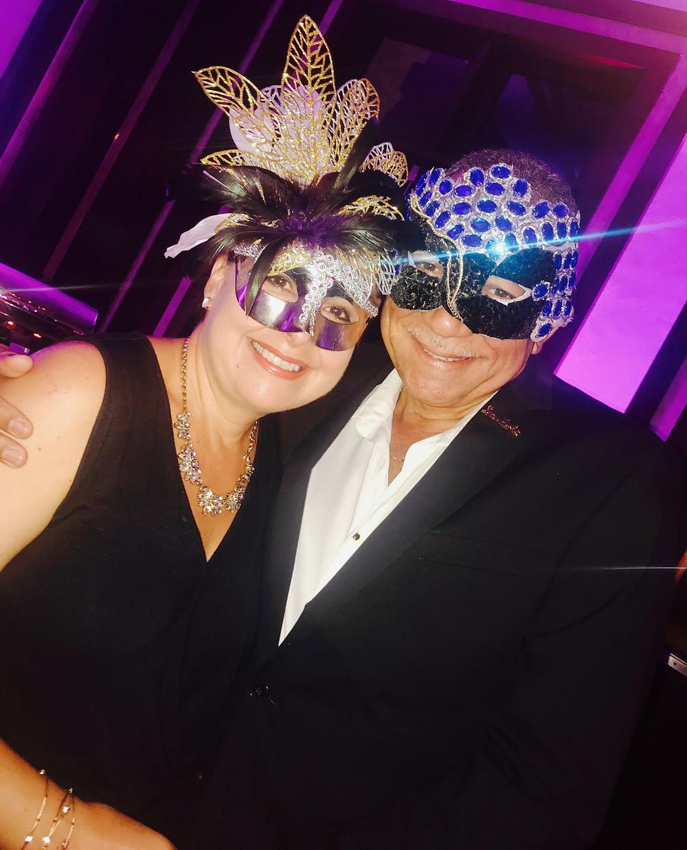 Masquerade party guests at Sandals Royal Barbados