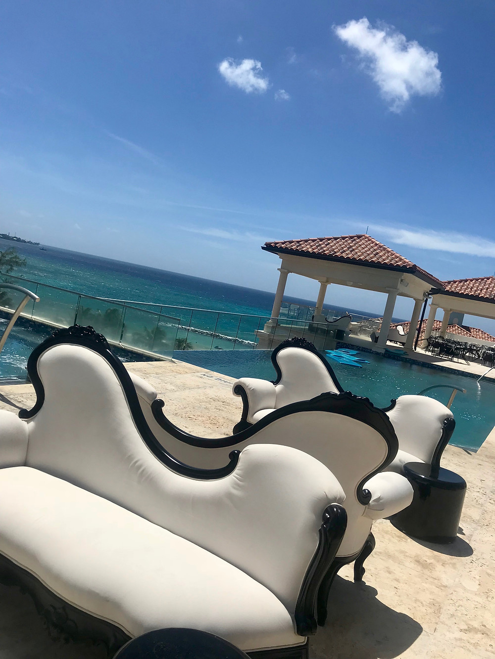 Fancy lounge chairs at at Sandals Royal Barbados