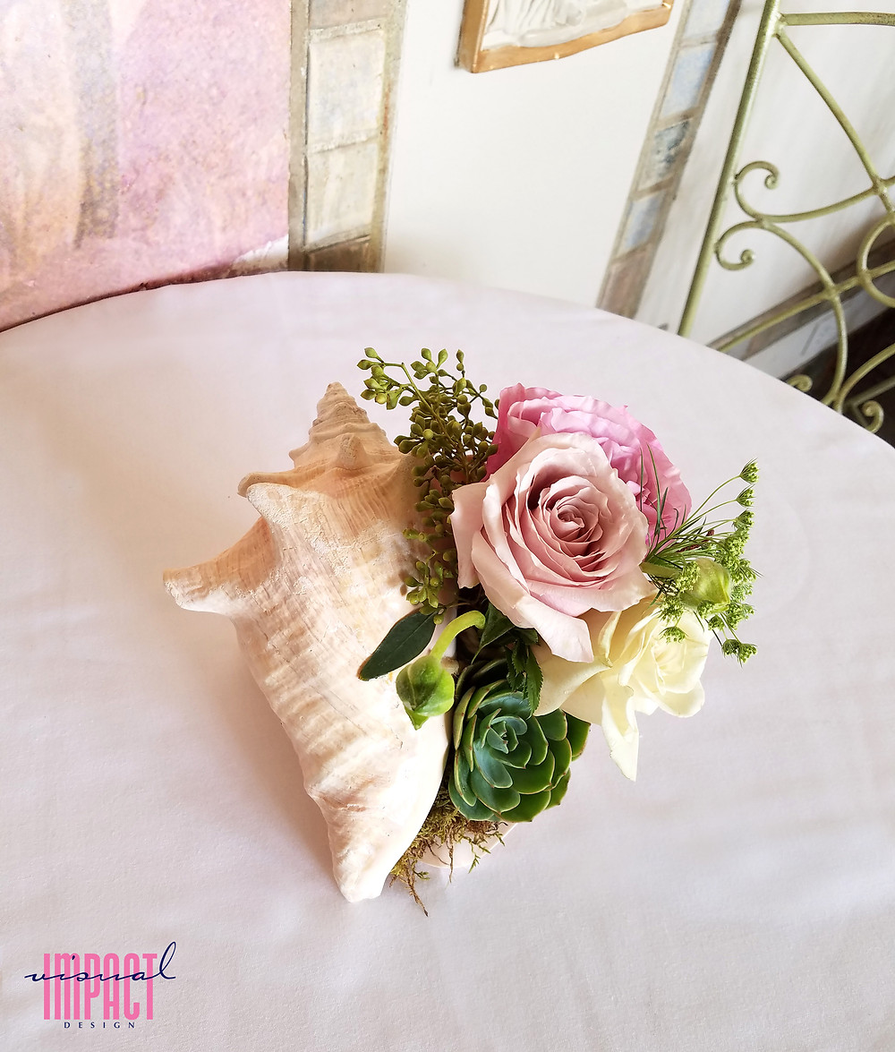 Blooming conch shell centerpiece by Visual Impact Design