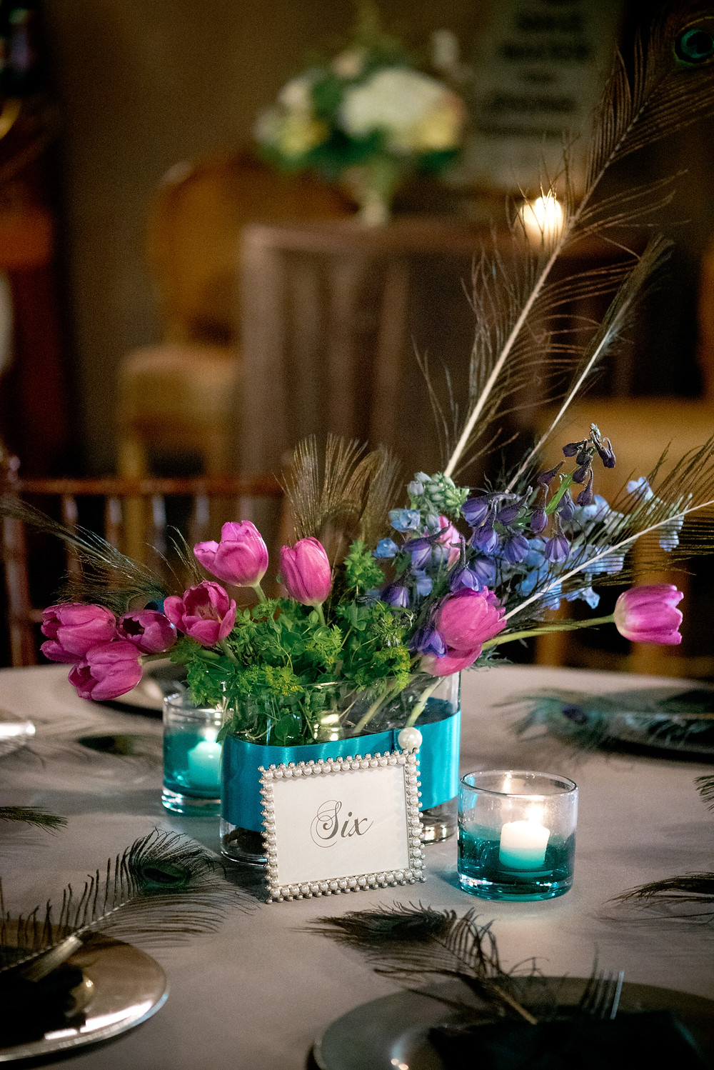 Peacock inspired centerpiece by Visual Impact Design | Photo by Allison Stahl Studio