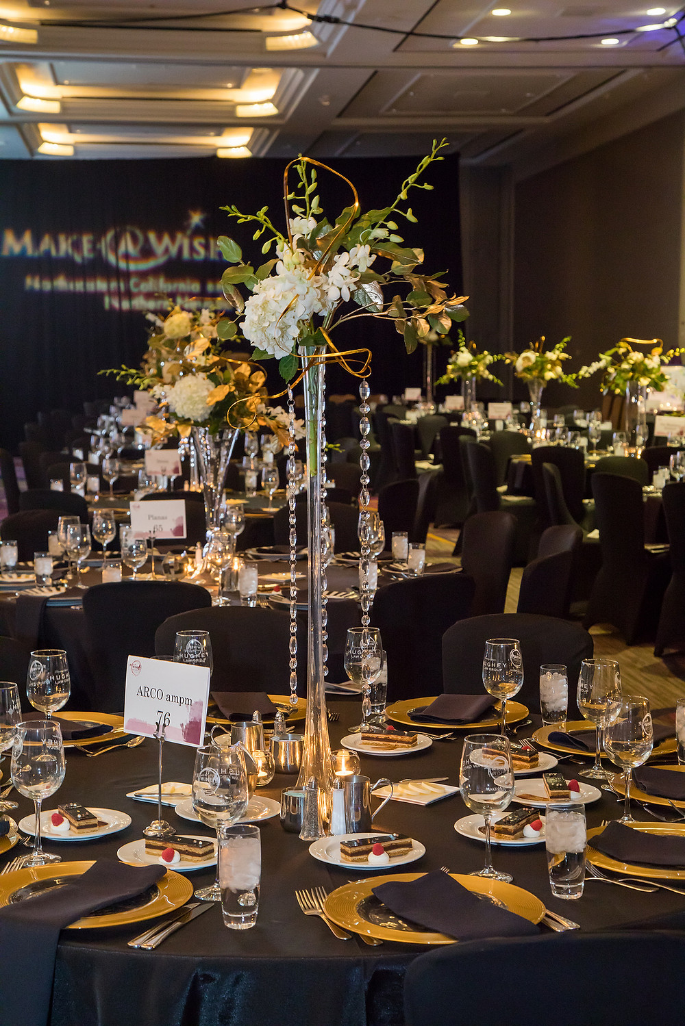 "Make-A-Wish ""Wine & Wishes"" event ballroom Sacramento, CA - centerpieces by Visual Impact Design"