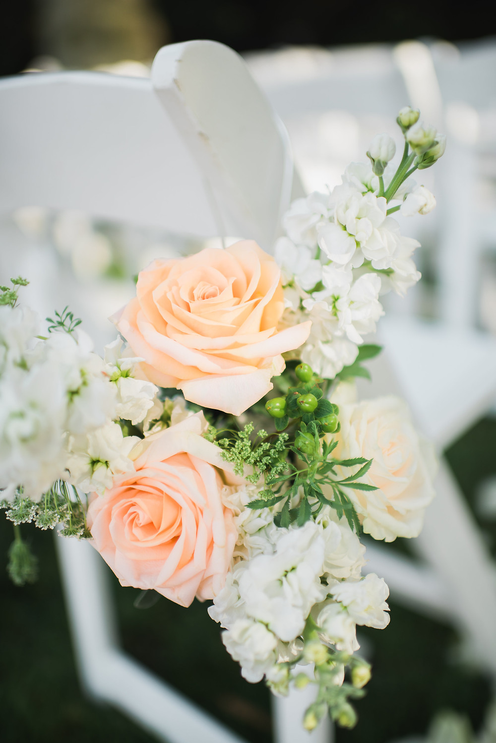 Aisle chair flowers | Visual Impact Design wedding flowers | Custock Photography