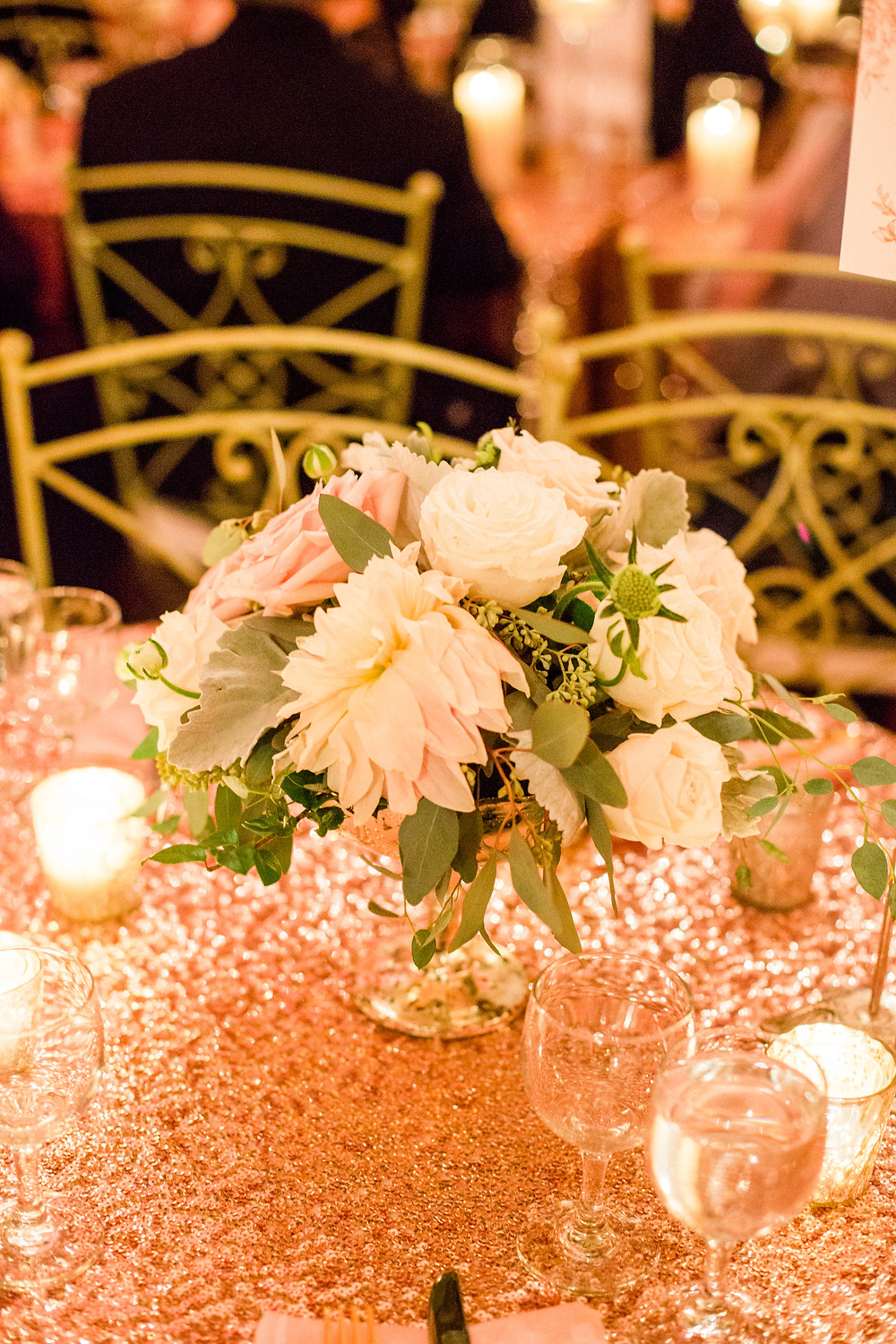 Blush pink and soft green centerpiece at reception