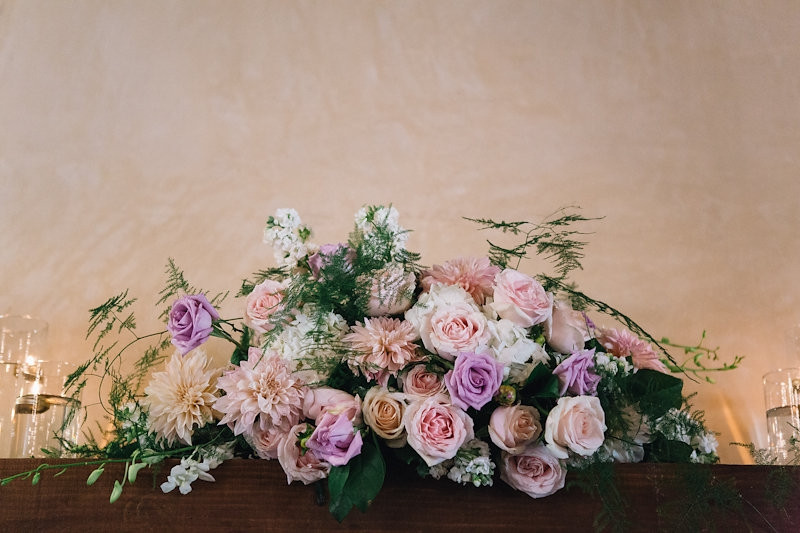 Catta Verdera reception | cream, blush and violet floral swag by Visual Impact Design wedding florist | Codrean Photography