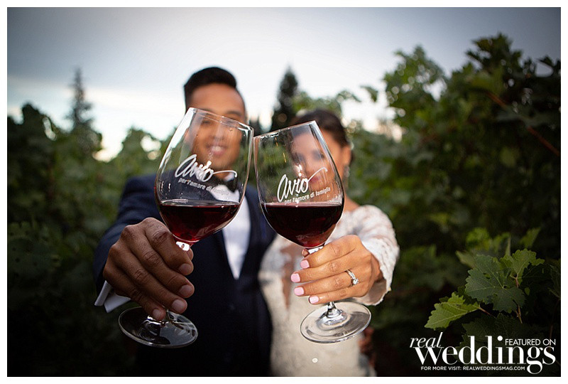 Bride and groom toast with wine at Avio Vineyard
