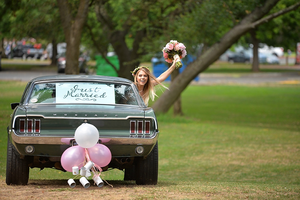 Just Married! Bride and Groom in their Mustang Getaway Car