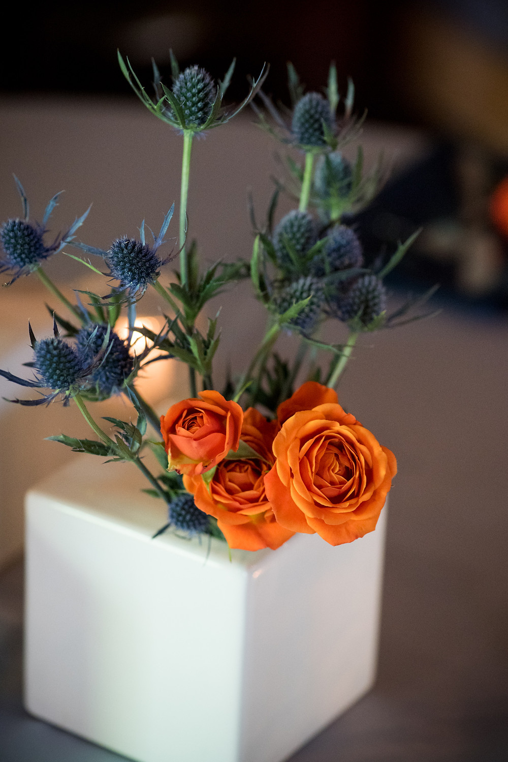 Orange and blue centerpiece by Visual Impact Design | Photo by Allison Stahl Studio