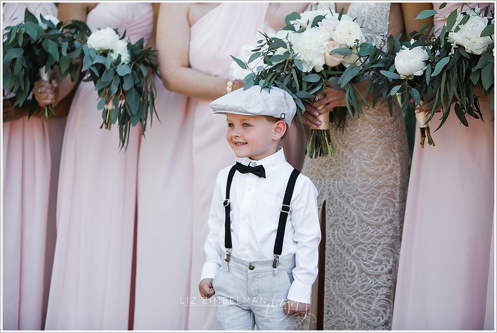 Ring bearer wearing a newsboy hat