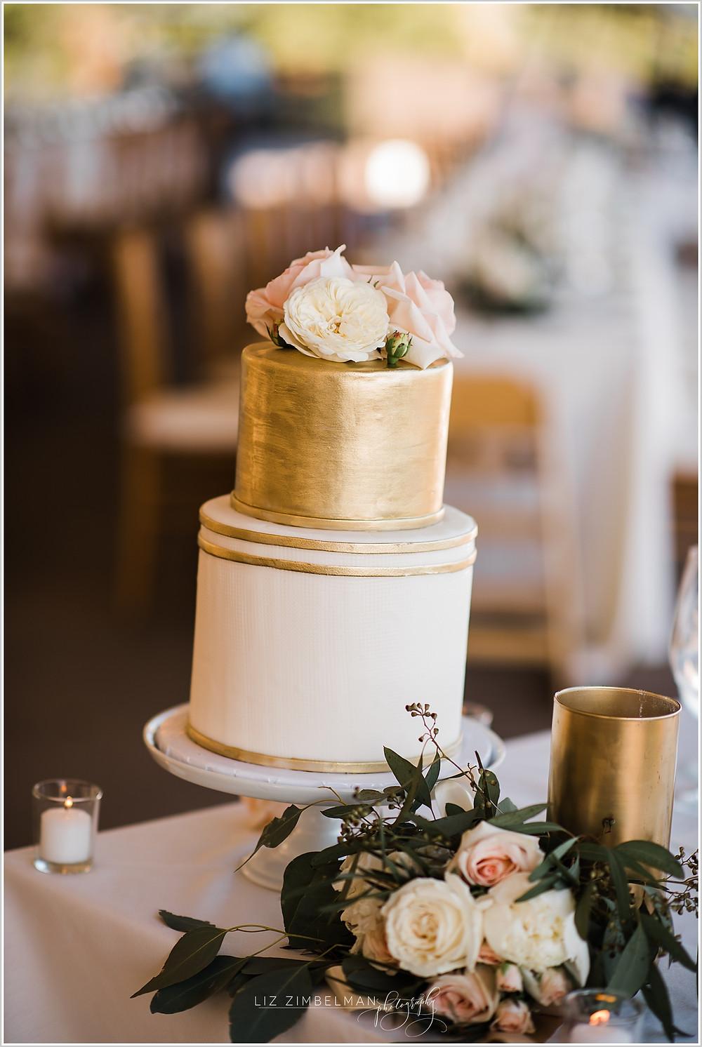 Cake topper flowers on wedding cake