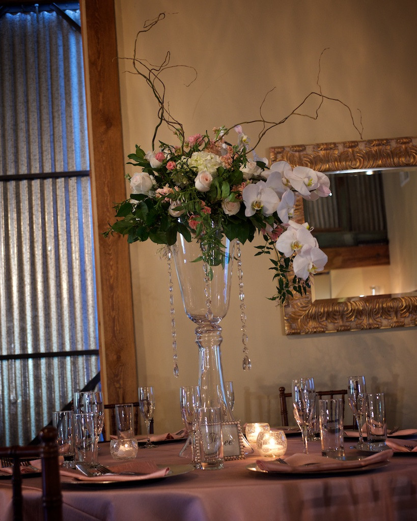 Tall centerpiece with cascading orchids, roses, hydrangea, curly willow branches and crystals by Visual Impact Design | Photo by Sharpe Weddings