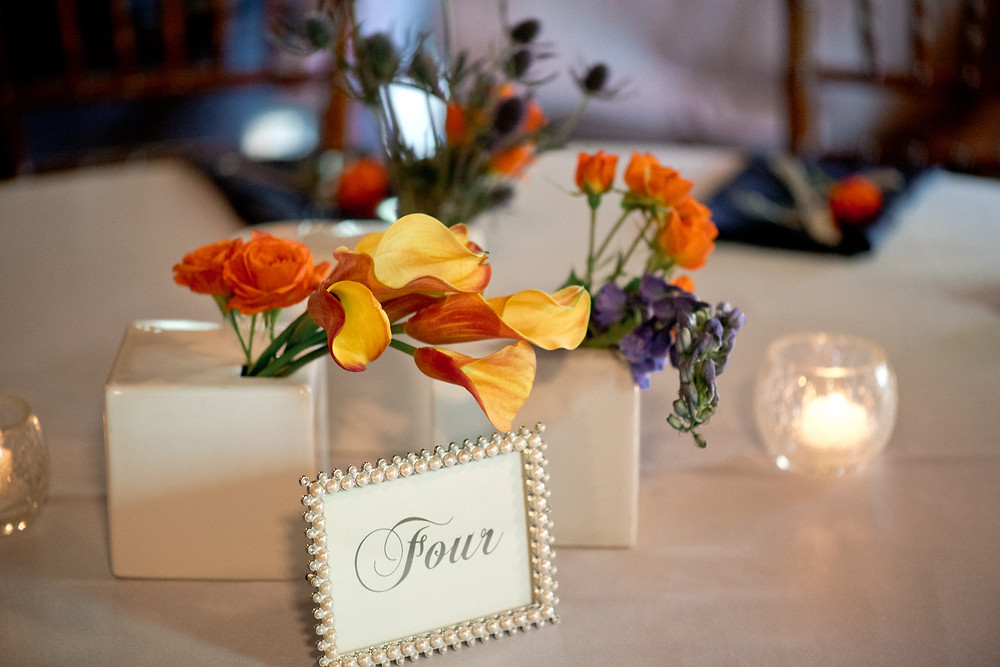 Orange, blue and purple centerpiece by Visual Impact Design | Photo by Allison Stahl Studio