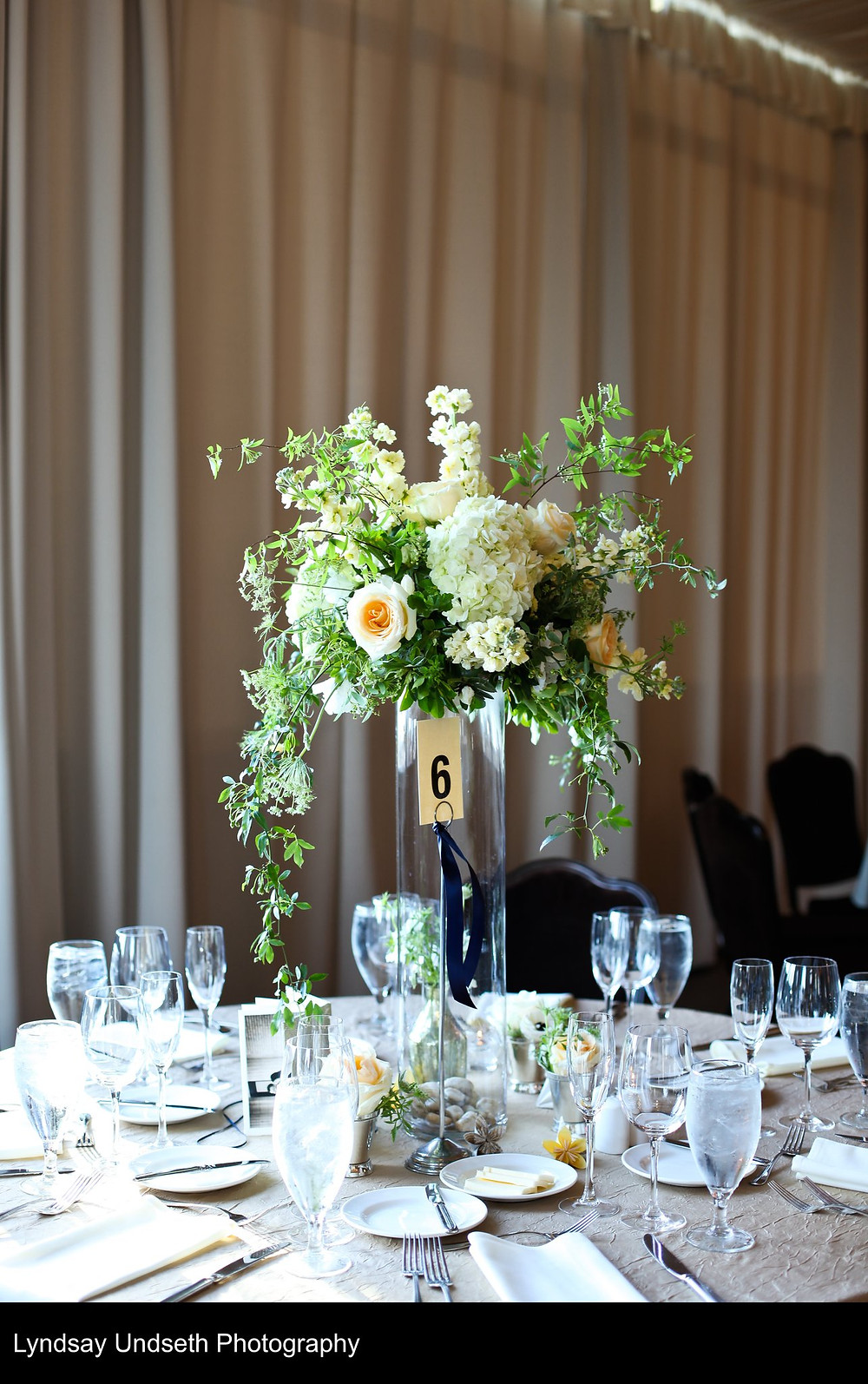 Tall floral centerpieces in buttercream, soft apricot, green and white by Visual Impact Design, Sacramento Wedding Florist | Kate Whelan Events | Lyndsay Undseth Photography | Citizen Hotel Wedding Reception