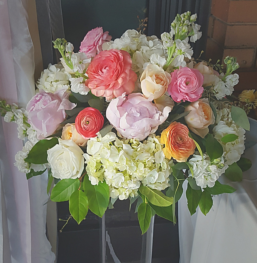 Large romantic floral display in pastels by Visual Impact Design