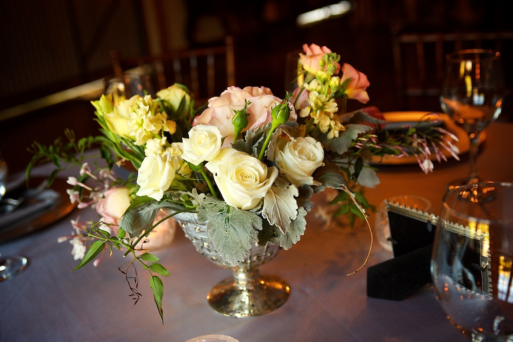 Pink, yellow and ivory garden centerpiece by Visual Impact Design | Photo by Sharpe Weddings
