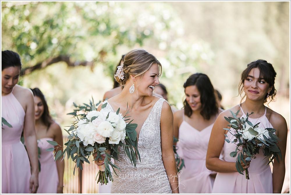Bride and bridesmaid walking to ceremony