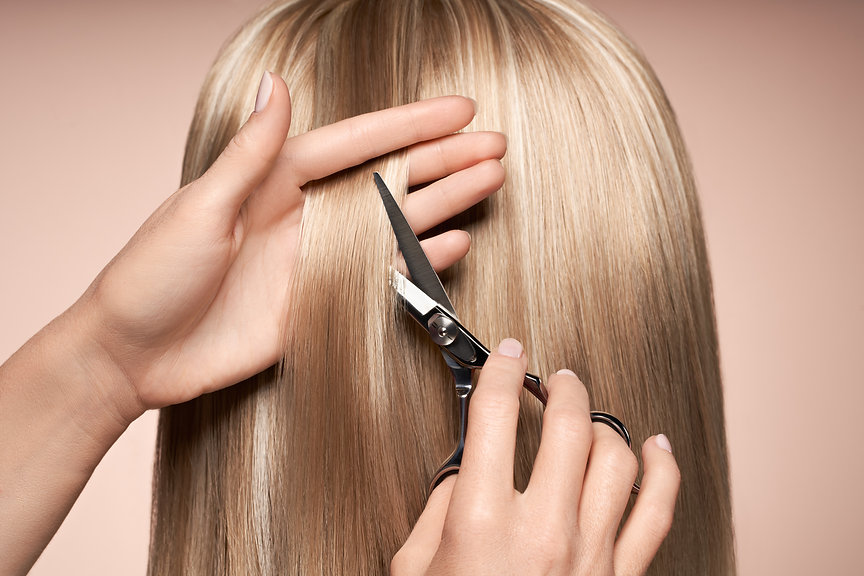 hairdresser-cuts-long-blonde-hair-with-s